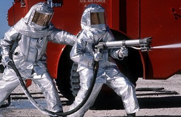 Fire_fighters_practice_with_spraying_equipment,_March_1981.jpg